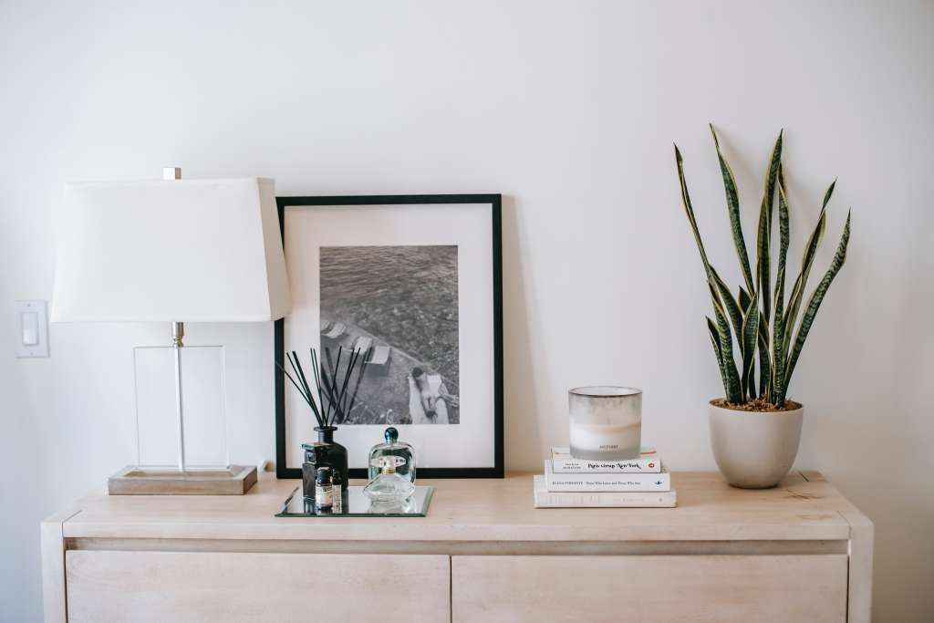 Arrange art with your other decor items in mind.